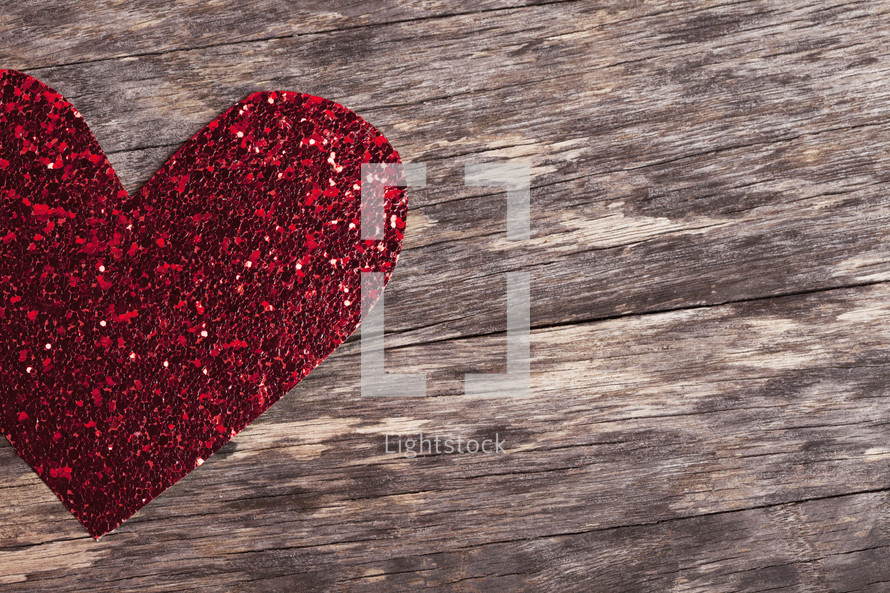 a red glittery paper heart cut-out