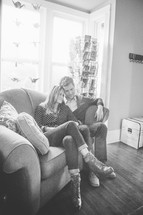 A man and woman sitting close together on the couch.