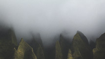 fog over green mountain peaks