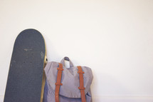 book bag and skateboard