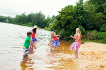 children playing in lake water