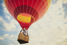 A couple kissing in a colorful hot air balloon - take you love to new heights
