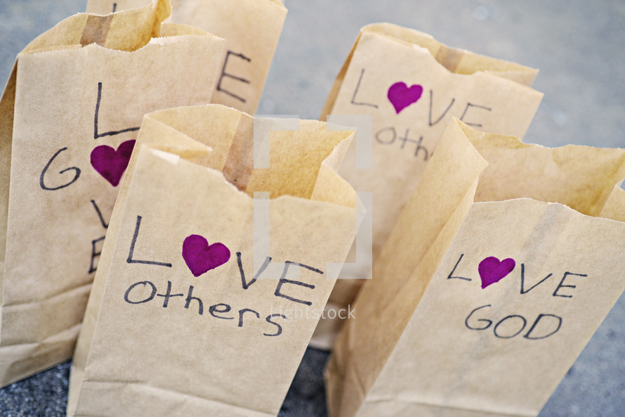 Love others, love God, paper bags