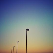 White street light poles