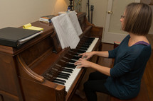 a woman playing a piano