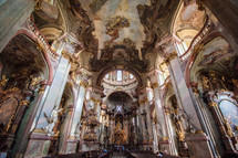 ornate and grand sculptures and statues inside an ancient cathedral