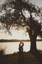A couple embracing near a lake