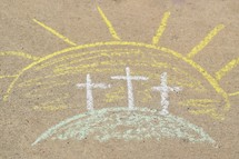 three Easter crosses on the mount in sidewalk chalk