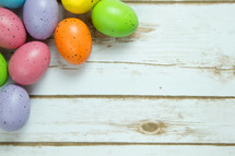 speckled Easter eggs on white wood boards