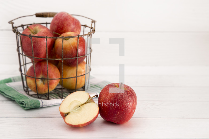 wire basket of red apples