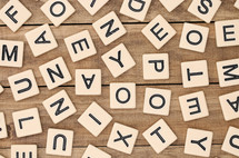 scrabble pieces scattered