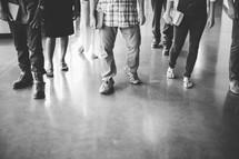 feet of parishioners entering a church
