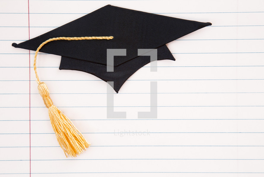 graduation cap on notebook paper