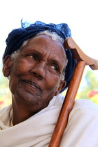 An elderly Ethiopic Orthodox woman her her prayer staff. [For Similar search Ethnic Face Smile]