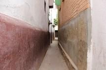 A narrow alley between buildings