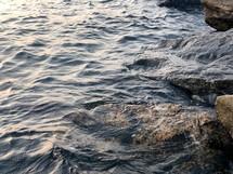 Light touching rocks on the seaside.