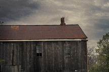 Old barn under a stormy sky.