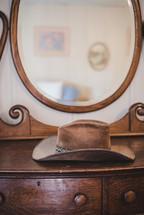 cowboy hat on dresser
