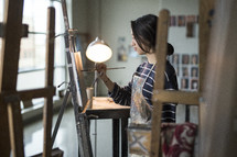 artist painting in a studio