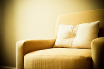 pillow on a yellow couch