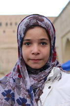 Young Yazidi girl with a shawl over her head  [For similar search 'Ethnic Face Smile' or 'Refugee']