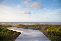 wood boardwalk leading to a beach
