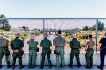 police officers looking over a bridge swat tribute highway patrol