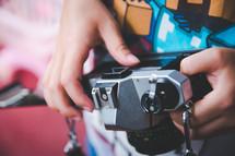 a boy child holding a vintage camera