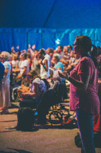 praising God at a worship service
