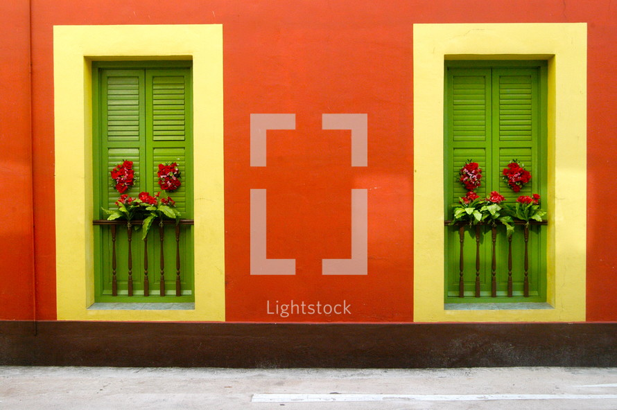 closed green shutters on a red house