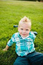 Boy playing in grass field