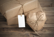 Packages wrapped in brown paper and tied with twine.