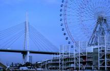 large Ferris wheel in front of a bridge in Japan