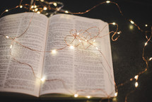 fairy lights on an open Bible