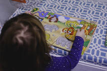 a toddler building a puzzle