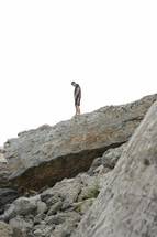 man standing on a mountaintop