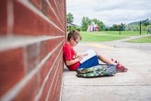 a boy sitting at school working on his homework