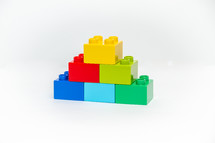 Pyramid of colorful building block bricks