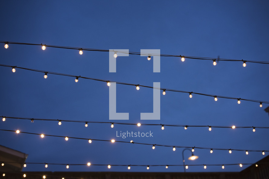 string of lights between buildings at night