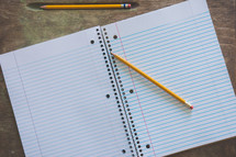 pencils on a spiral notebook