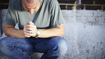 Man kneeling in prayer