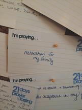 bulletin board of notes regarding prayer