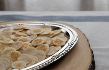 communion wafers in a silver tray