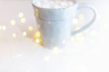 fairy lights and a mug of hot cocoa