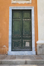 old green wooden door in Italy