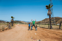 man and children on a dirt road in Mexico