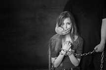 kidnapped woman in chains