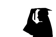 silhouette of a graduate turning her tassel