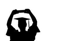 male graduate with Bible raised above his head