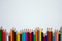 border of colored pencils